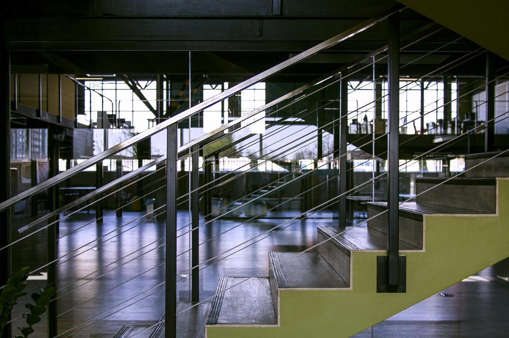 All metal commercial handrail on both sides of staircase